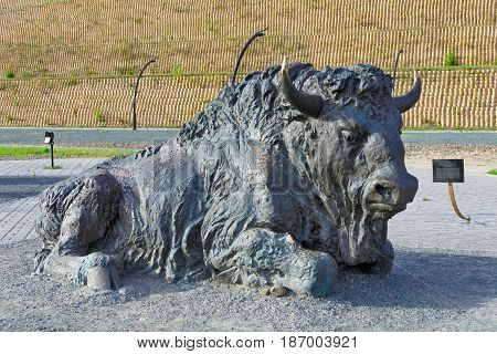 Editorial.Khanty-Mansiysk Yugra Russia August 12 2012 Archeopark Samarovo town.The part of sculptural composition Primitive bison