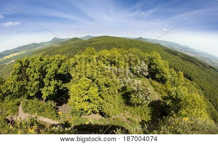 View on the protected landscape area Czech Central Mountains from the top of the hill Kostalov Czech republic.