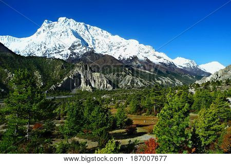 Beautiful View Of Annapurna And Gangapurna Range. Colorful Nepalese Autumn.