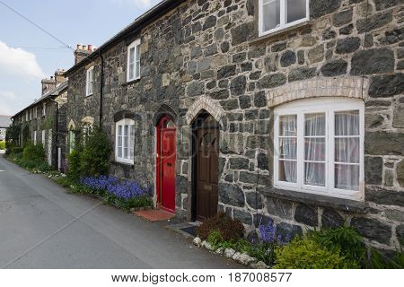 Bala Wales UK - May 3 2017: A row of traditional stone built terraced cottages in Wales typical of 19th century miners or rural workers housing now generally used for holiday or starter homes
