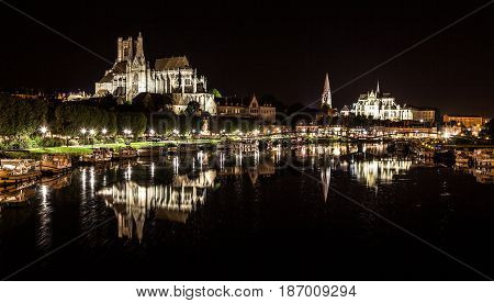 Historic Town Of Auxerre With Yonne River At Night, Burgundy, France