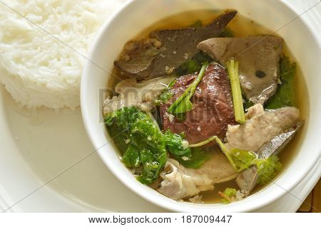 boiled pork blood and entrails soup eat couple with rice on plate