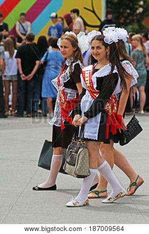 Volgograd Russia - May 25 2013: Girls in soviet school uniform the bows and the ribbon