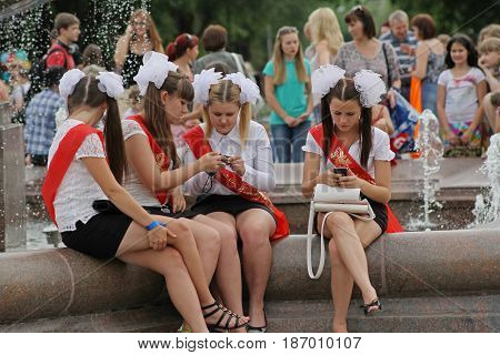 Volgograd Russia - May 25 2013: Girls in school uniform the bows and the ribbon