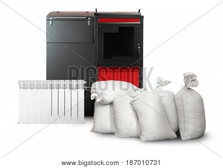 Bags with radiator and solid fuel boiler on white background. Energy savings concept