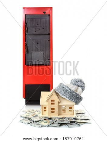 Toy house with money and solid fuel boiler on white background. Energy savings concept