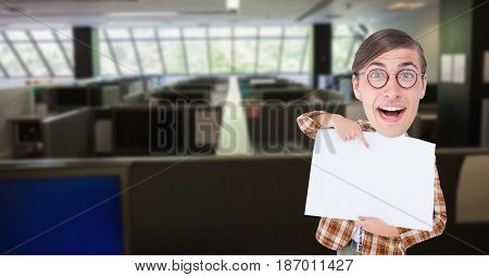 Digital composite of Happy nerd pointing at blank placard in office