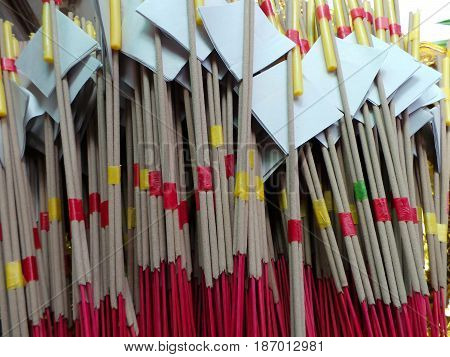 Joss sticks on the tray and background
