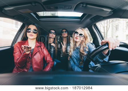 Group Of Friends Having Fun Whet Drive The Car. Singing And Laughing On The Road