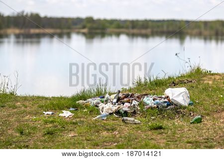 A lot of garbage at the tourist destination on the lake