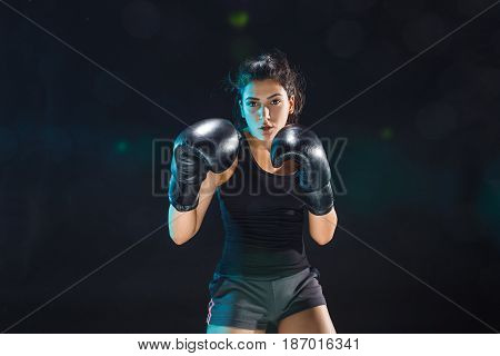 The female boxer boxer training at gym