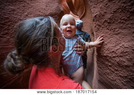 A mother and her baby son visit Lower Antelope canyon in Arizona