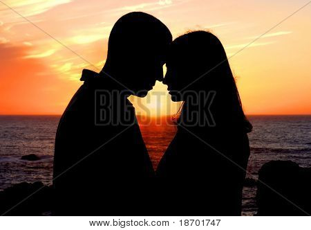 Young couple in love enjoying sunset