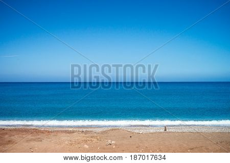 Calm blue sea and sky. Travel background. Summer vacation holiday on the beach.
