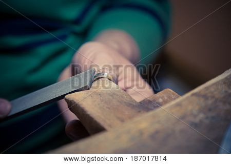Goldsmith working on wedding ring. Crafting process