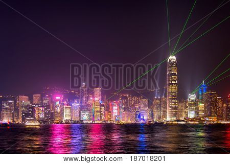 Hong Kong skyline at night. Lasers and light beams on the Skyline are part of the Symphony of lights show.
