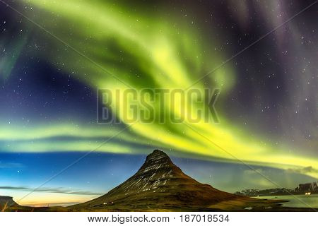 Northern Light Aurora Borealis At Kirkjufell Iceland With Fully Start In The Sky