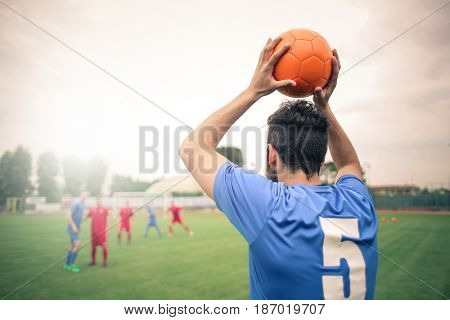 Soccer player throwing the ball in