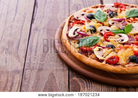 Delicious fresh pizza with seafood. Seafood Italian Pizza slice on wood table horizontal