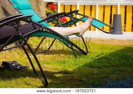Female Bare Feet. Woman Relaxing On Sunbed
