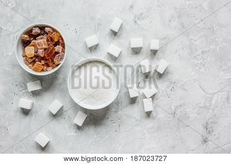Set of white and brown sugar on stone desk top view