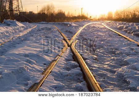 Rail road in the sun light in winter. Travel choice concept.