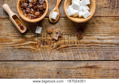 Set of white and brown sugar on wooden table