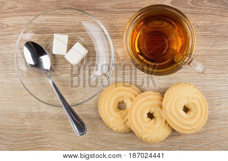 Cup With Tea, Spoon And Lumpy Sugar In Saucer, Cookies