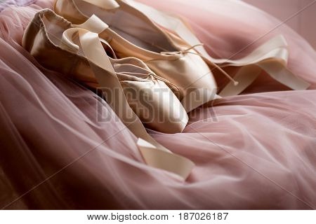 Pointe Ballet Shoes on pink background. Pointe shoes for a ballerina