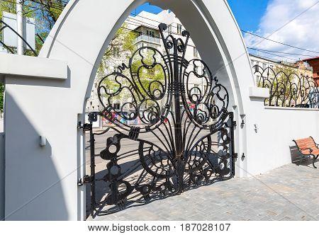 Samara Russia - May 09 2017: Openwork gate of Samara museum Kurlina's House in sunny day in Samara Russia
