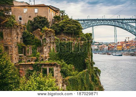 Abandoned ruins on the banks Douro river in the Porto old town, Portugal.