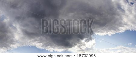 Gloomy sky with a large storms cloud in summer