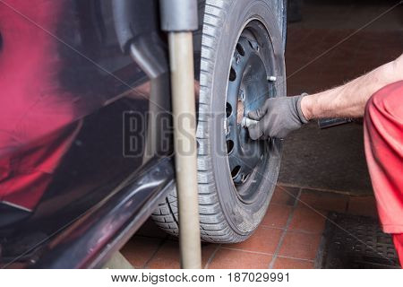 tyre change in the car repair - car on lift