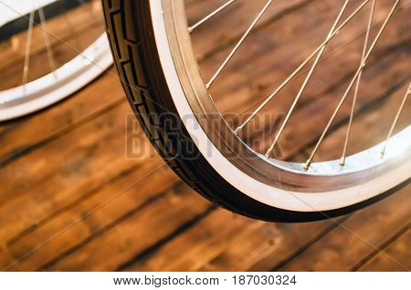 Wheel Of A Stylish Bicycle With A White Rim And A Brown Rubber Tire On A Stylish Wooden Background.