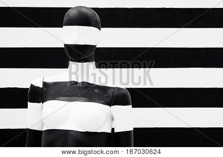 Art mannequin black and white stripes on striped with black and white stripes. Disguise