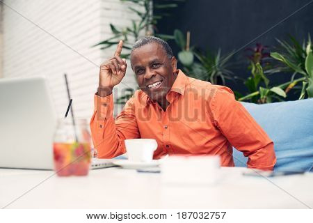 African American businessman sitting at a cafe table