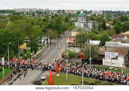 Orel Russia - May 9 2017: Victory Day selebration. Large crowd of people marching in Immortal Regiment viewed from bird view