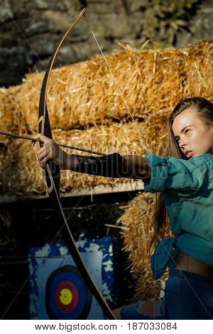 Confident Cute Woman Archer Shooting With Bow And Arrow