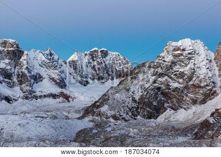 Beautiful Snow And Ice Covered Mountains Landscape And Clear Blue Morning Sky On Everest Base Camp T