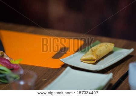 Baked Roll With Banana On A Plate