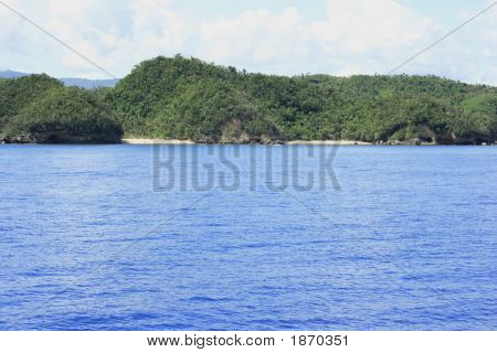 Mountain In A Blue Water