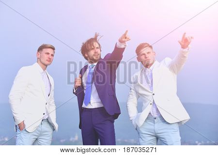 People Of Young Man, Businessman And Guys On Blue Sky