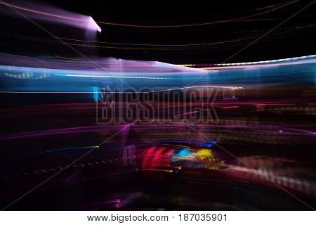 Motion. Colorful lighting lights moving on dark background. Abstract neon glowing lines or trails. Nightlife and technology