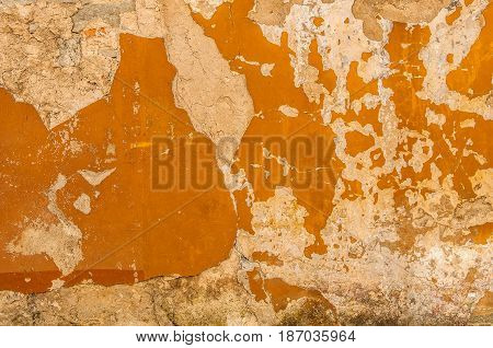 Dark Plaster Wall With Dirty Yellow Scratched Horizontal Background. Old Brickwall With Peel Swamp Color Stucco Texture. Retro Vintage Worn Wall Wallpaper. Decay Crack Rough Abstract Banner Surface.