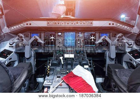 Airplane cockpit of Embraer-175 on a horizontal format
