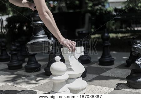 A strategy game of chess the players are thinking that a move drag black and white pieces of chess and chessboard