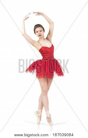 A young girl in a red tutu dancing ballet. Studio shot on white background, isolated image.