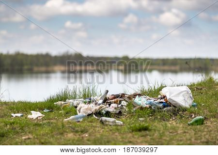 Garbage dump on the lake nature environment problems