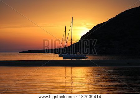 Fabulous Sunset in Cyclades islands, Greece. Sailboats
