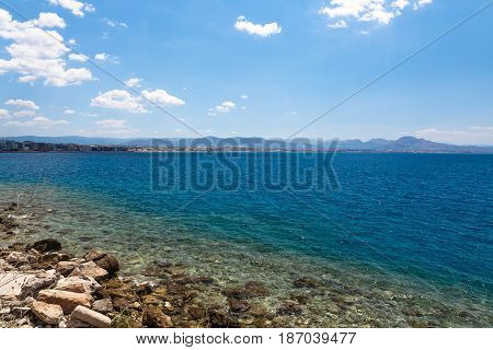 Loutraki Cityline view from Aegean sea in Greece.